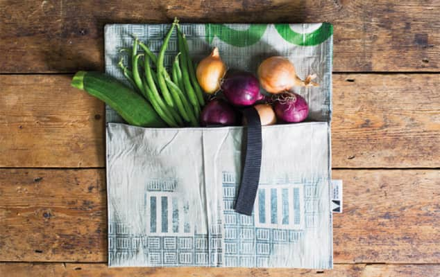 Image of a bag filled with vegetables on top of a wooden table