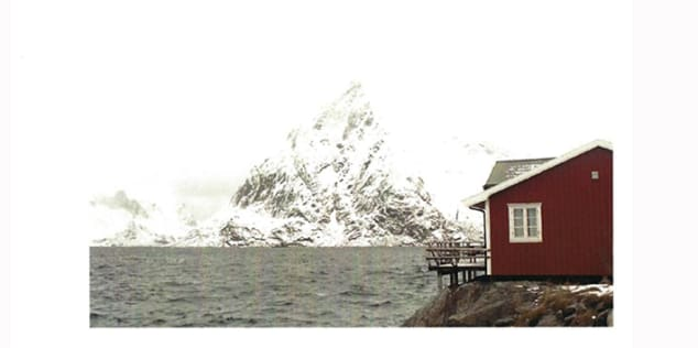 Photographic image by Claire Barthelemy in a red house and mountain by a river in Norway.