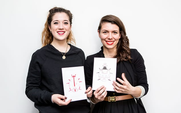 Photograph: Two LCC students pictured with the work they created in collaboration with Ladybird.