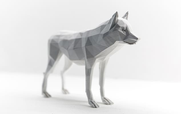 Image of a a grey wolf animation, with a white background.