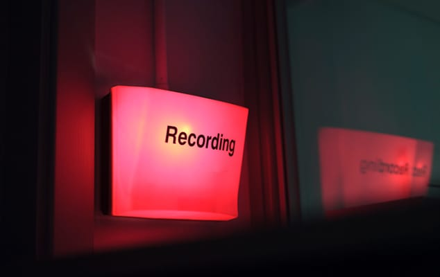 Photograph showing a red recording light, indicating the lens and audio visual facilities at London College of Communication.