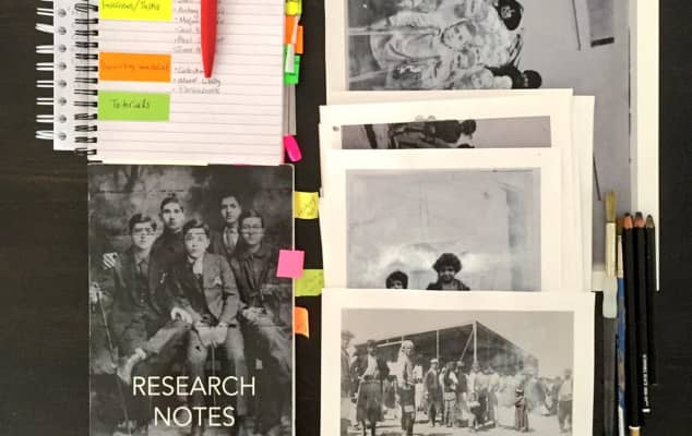 Books with pages marked, images and notes about research