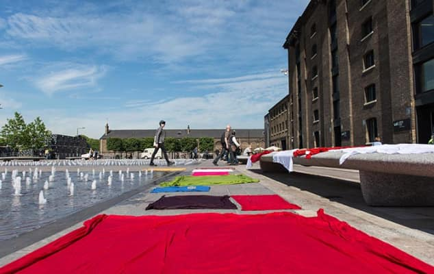 Image of Granary Square in London with colourful beach towels on the floor.