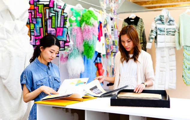 Visitors viewing portfolio of Fashion Knitwear students at Summer Shows 2013: Central Saint Martins