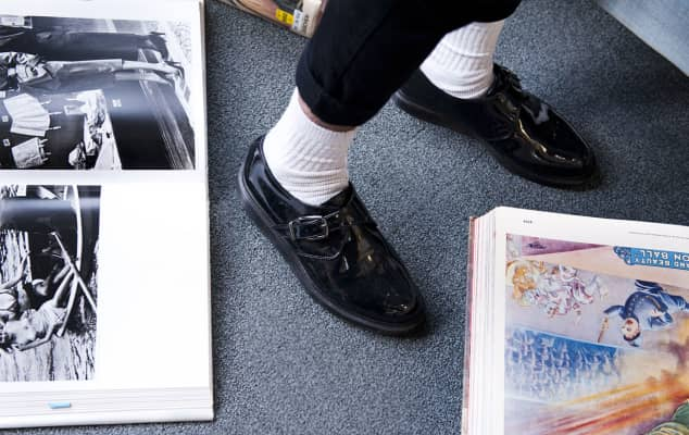 Student feet and books at London College of Fashion Library, by Ana Escobar, 2013