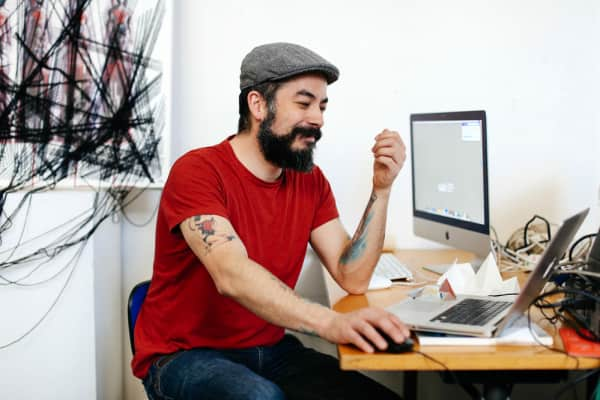 Man at laptop, London College of Communication