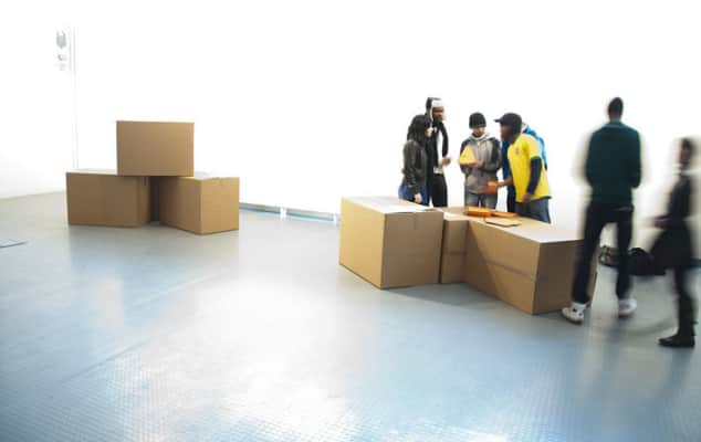 Image of students working with piles of boxes