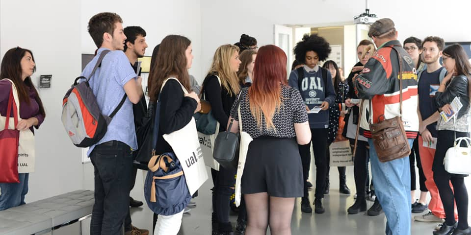 Students in discussion in a gallery space during London Design Programme.