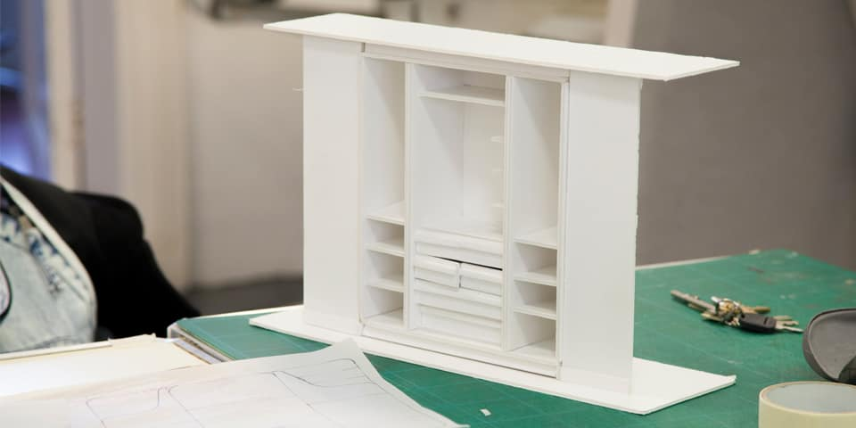 A foam board model of a bespoke furniture design made during a short course.