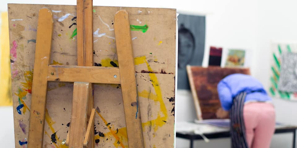 Student working on a painting during a fine art short course.