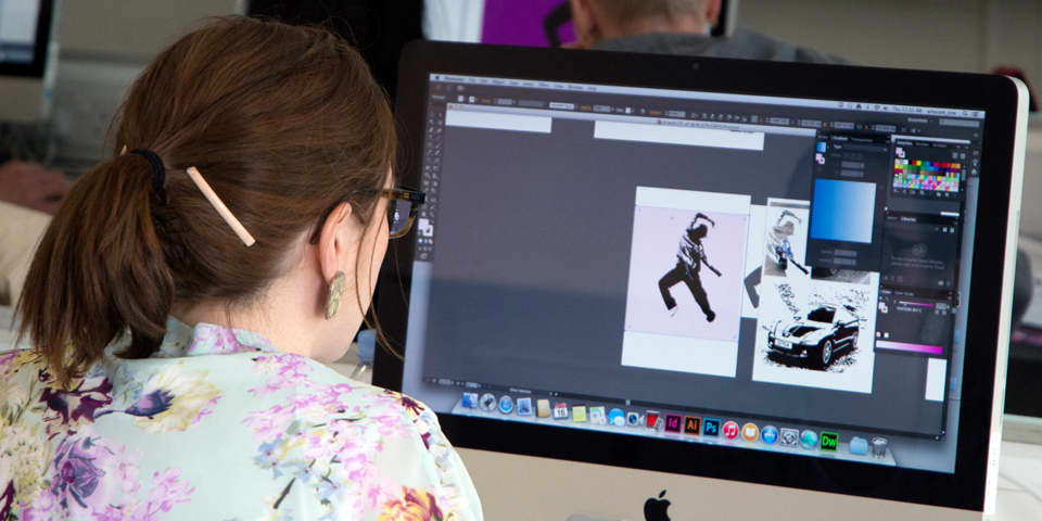 Student working in Photoshop during Photoshop, Illustrator and InDesign Course