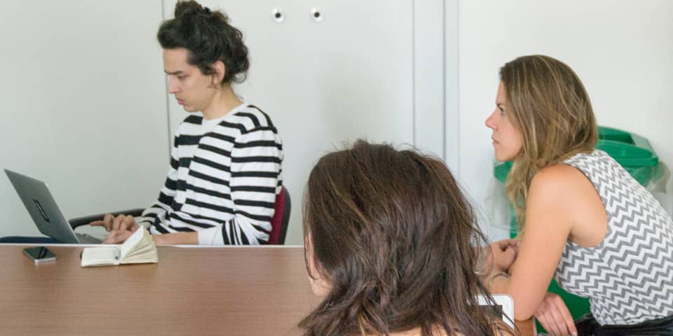 Students around a table during Creative Copywriting short course