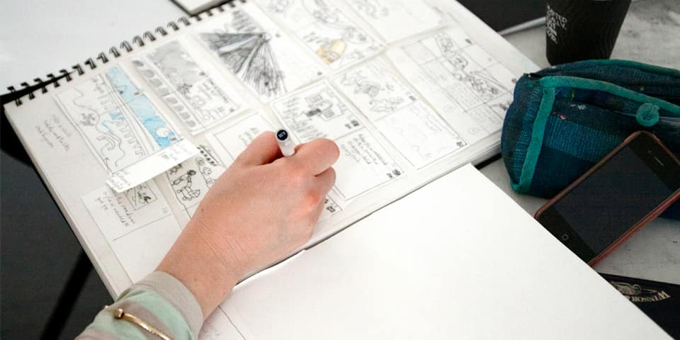 Student putting together comic stripe during a summer study abroad course.