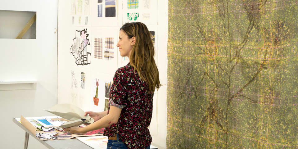 Student presenting their work at the end of Summer Study Abroad Digital Textile Design.