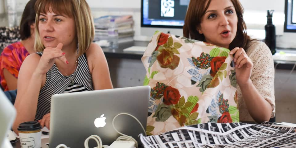 Students in discussion in the studio during Summer Study Abroad Digital Textile Design.