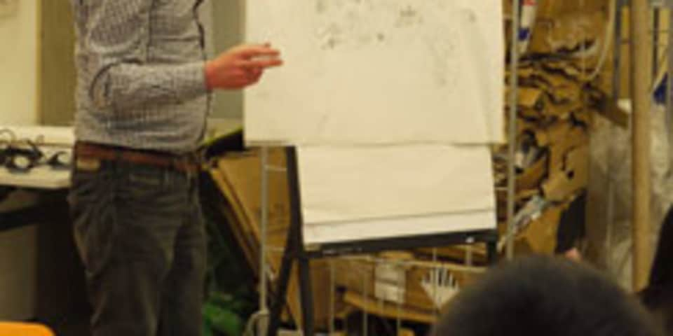 Man with flip chart talking, CSM, 2013.