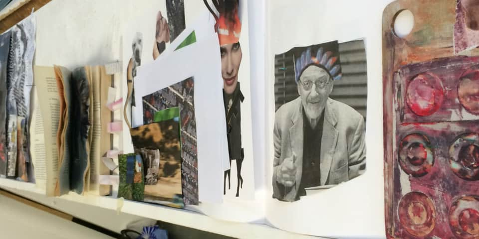 Image of student collage work - showing books and prints on a shelf