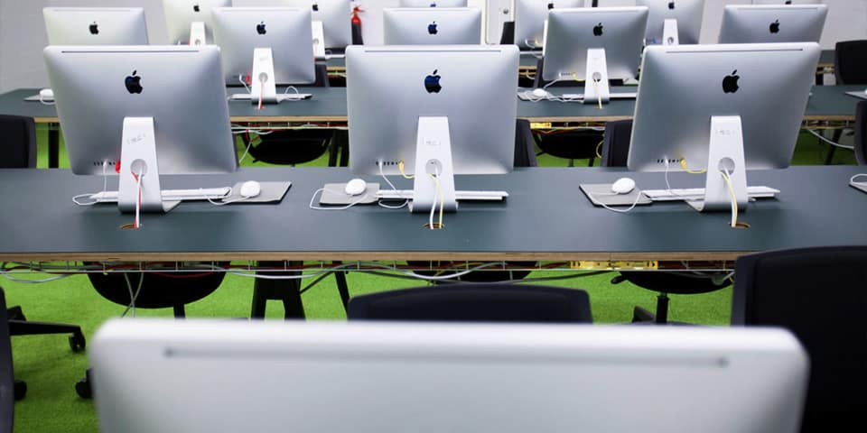 Bespoke training courses for professional development with Adobe Creative Cloud, Animation software & Web design at London College of Communication - Picture of classroom with MAC computers in the classroom.