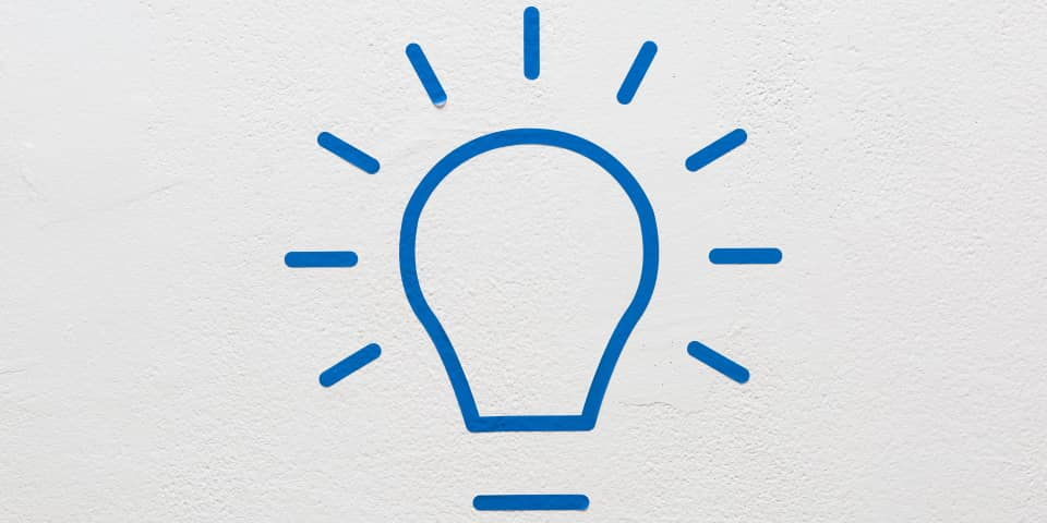User Experience (UX) Design Online Short Course at London College of Communication - Image of A grey background with blue outline of a bulb.