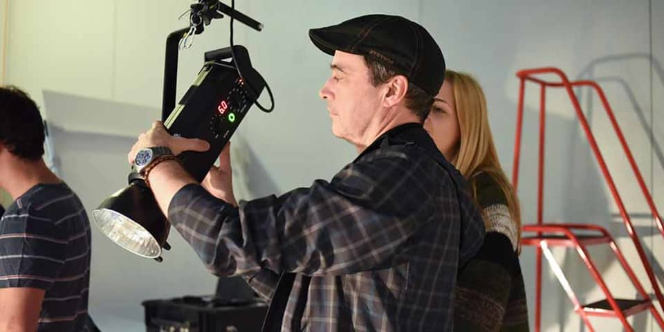 A class in a photographic studio adjusting lighting
