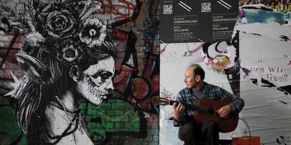 Magnum Documentary Short Courses at London College of Communication - Image of Guitar player against wall with graffiti