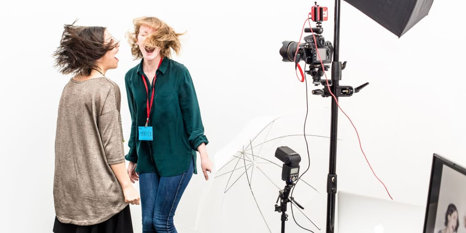 two students jumping in a photo-shoot