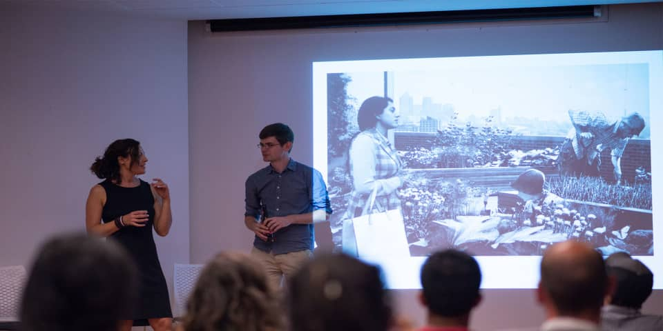 Magnum Documentary Short Courses at London College of Communication - Image of Student and tutor on stage. Student giving final presentation