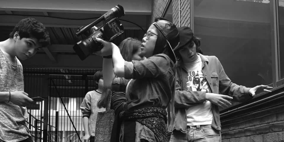 Summer Filmmaking short courses at London College of Communications - Image of Students filming on location.