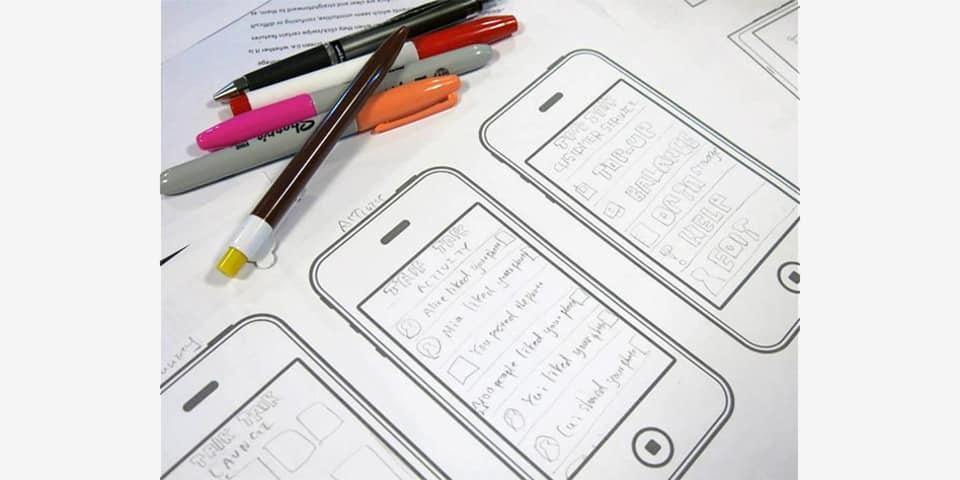 Drawn phone app design mock-ups.