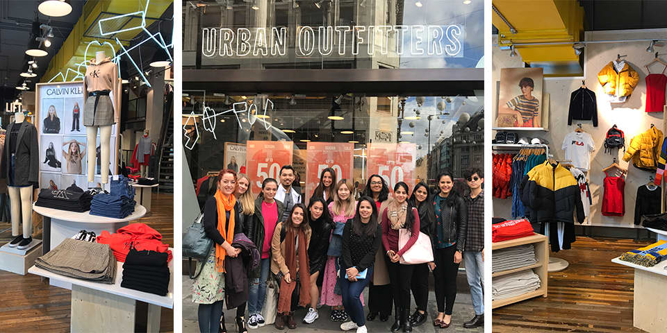 Students outside Urban Outfitters on study trip
