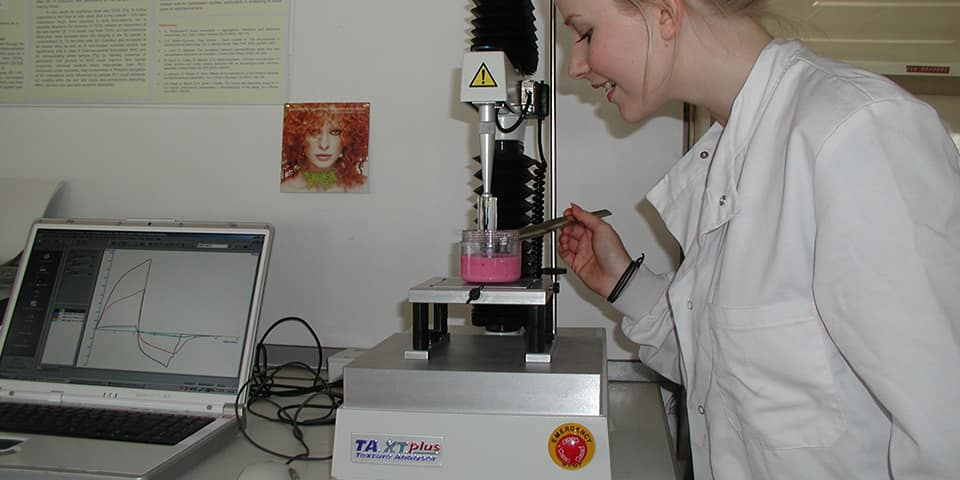 MSc Cosmetic Science student assessing the structure of a pink gel using laboratory equipment