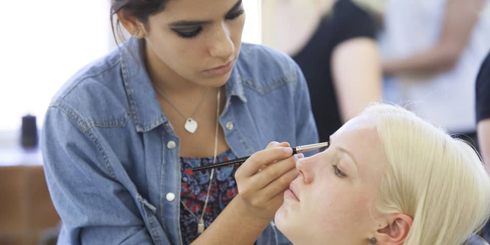 Student and model on makeup course for 16-18 year olds