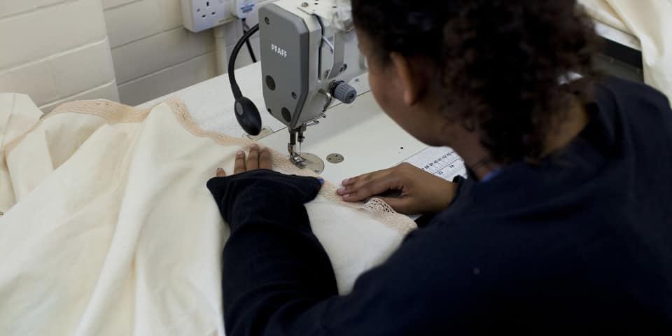 Introduction to Pattern Cutting and Sewing Techniques (16-18 Year Olds): student works on machine