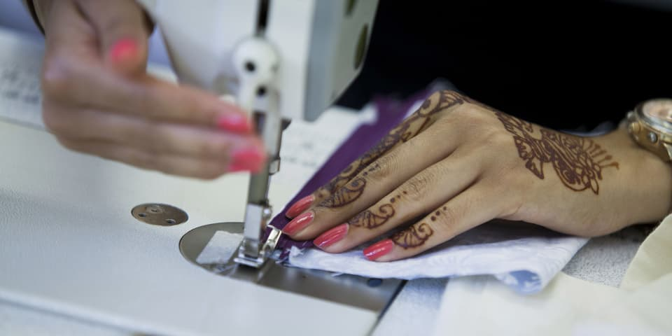 Pattern Cutting and Sewing Techniques: student works on machine