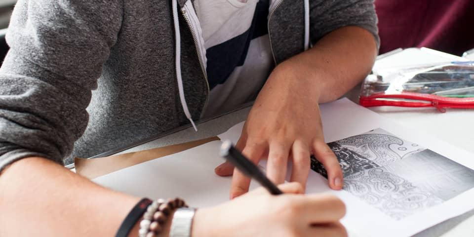 Fashion Portfolio Preparation student works on sketchbook