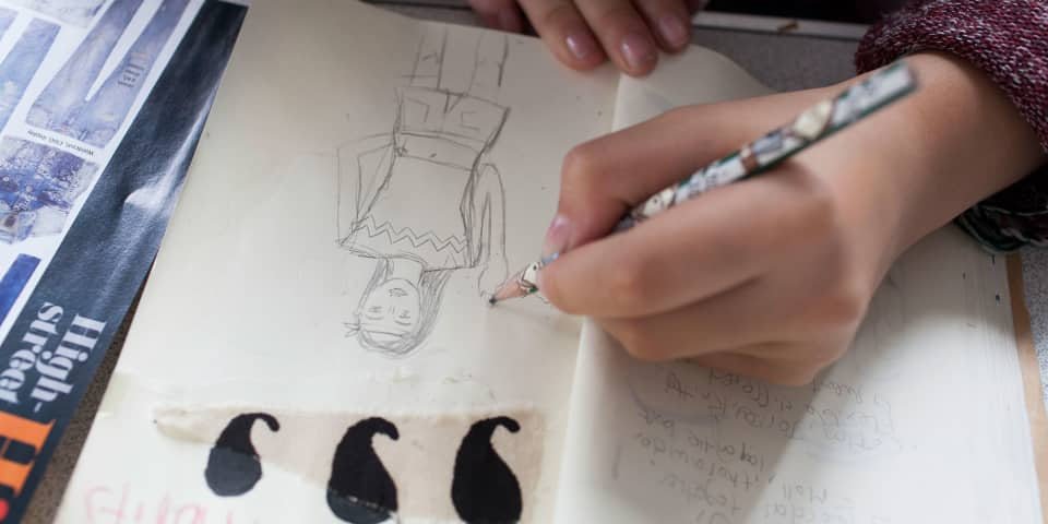 Fashion Portfolio Preparation student works on sketchbook