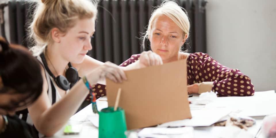 Fashion Portfolio Preparation students and tutor in class