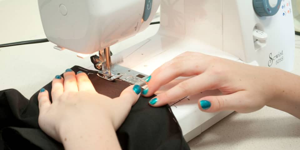 Fashion Design & Making: Student at sewing machine