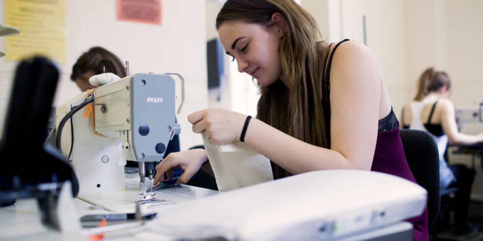 Definitive Guide to Sewing and Garment Making student in class