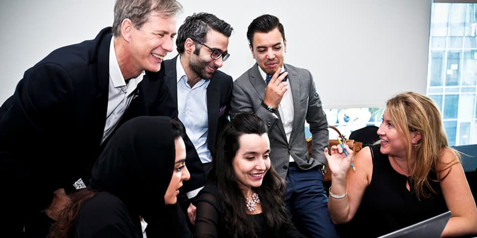Luxury Brand Management course tutor, Dr. Pascal Portanier, with students