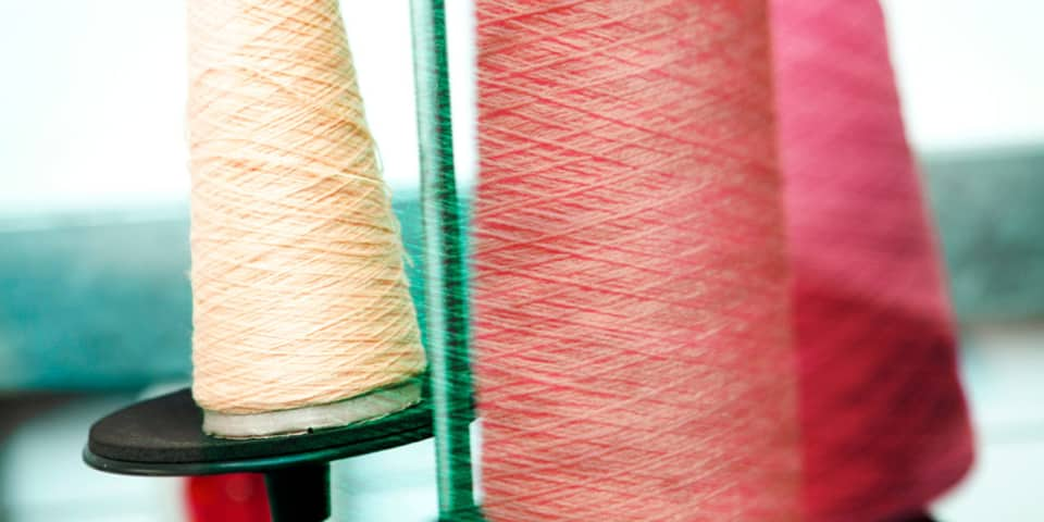 Producing Your Own Fashion Label - threads during production