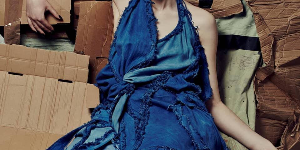 Girl in blue knit dress