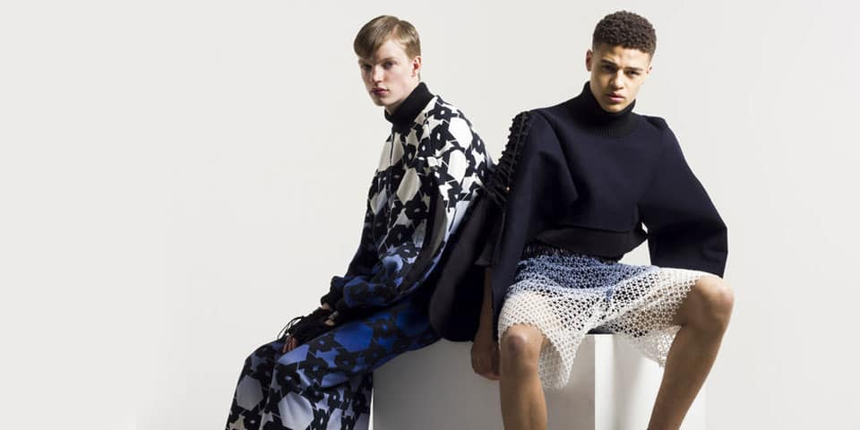 Two seated male fashion models