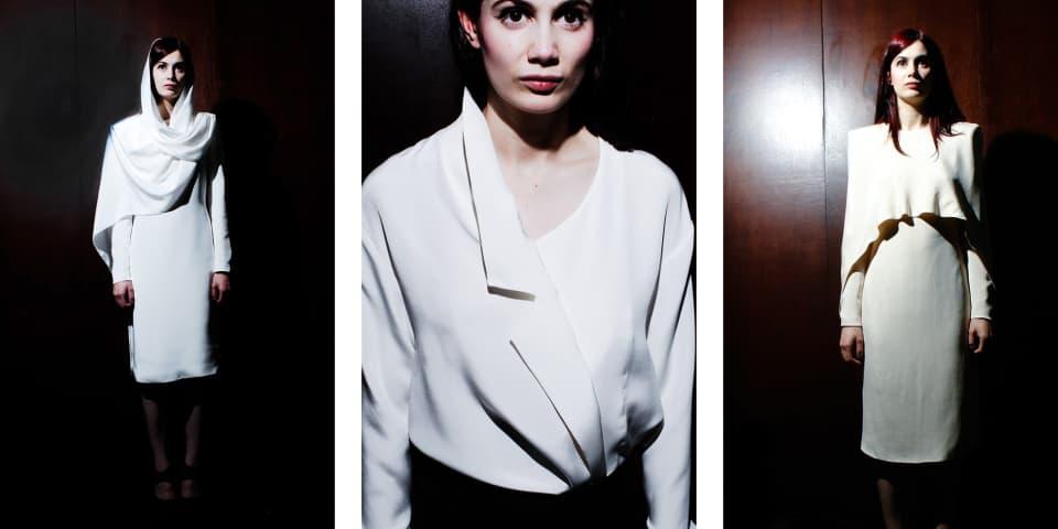 A model wears draped silk dresses