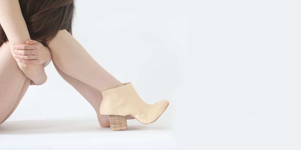 Girl with nude coloured shoes on.