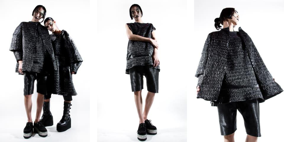 Models wear black PVC clothes