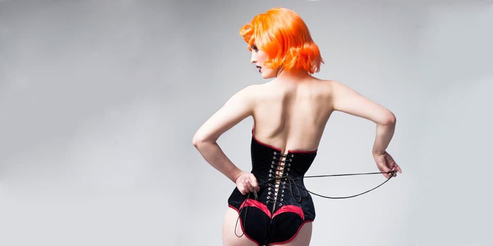 Model with orange hair in corset