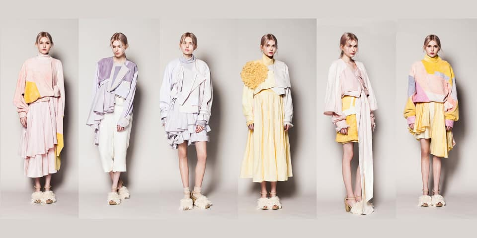 A female model in layered pastel looks