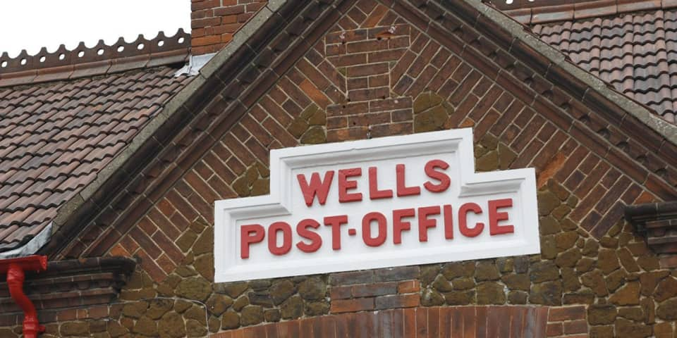 Photograph of architectural lettering: Wells Post Office