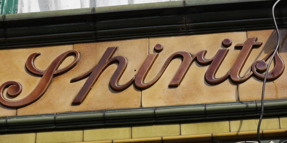 Photograph of architectural lettering: spirits
